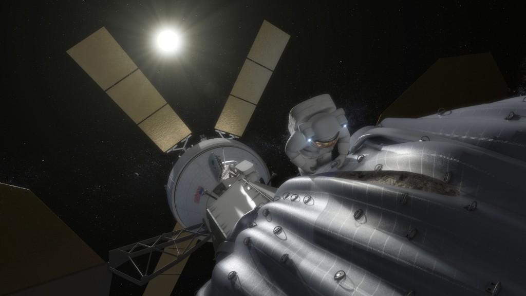 Esta imagen de concepto muestra un astronauta preparándose para tomar muestras de un asteroide capturado después de ser reubicado en una órbita estable en el sistema Tierra-Luna. Cientos de anillos se colocarán en la bolsa de captura del asteroide, ayudando al astronauta a recorrer la superficie cuidadosamente. (Crédito: NASA)
