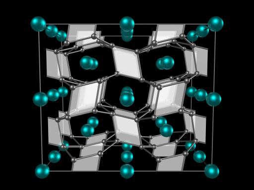 Estructura de cristal de FeB4 (tetraboruro de hierro) predicho por los primeros principios y confirmado experimentalmente. Los átomos de hierro (esferas pequeñas) están insertadas en un marco 3D rígido formado por átomos de boro (esferas grandes). (Crédito: Binghamton University)